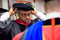 RHIT_Commencement_Platform_Party_Robing-21634.jpg
