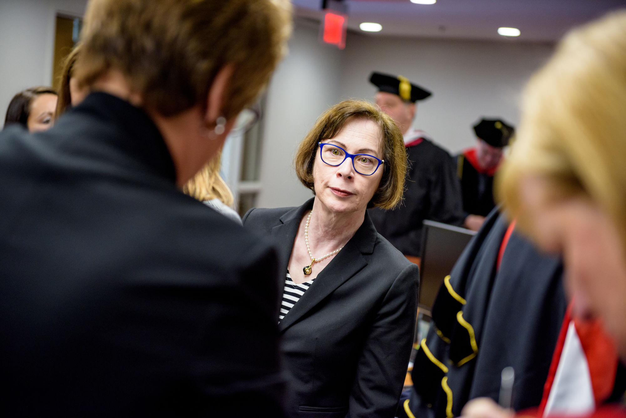 RHIT_Commencement_Platform_Party_Robing-21567.jpg