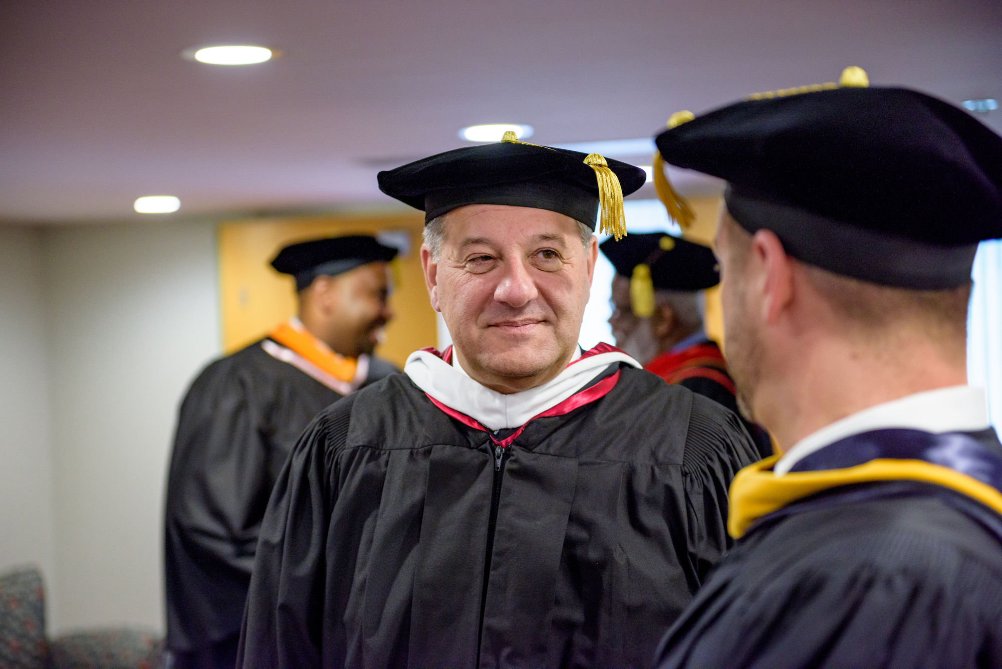 RHIT_Commencement_Platform_Party_Robing-21597.jpg